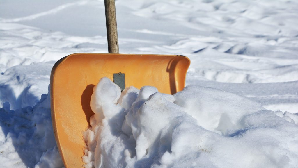 Yellow snow shovel used by a snow removal company