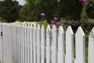 Outdoor fence companies install white picket fence
