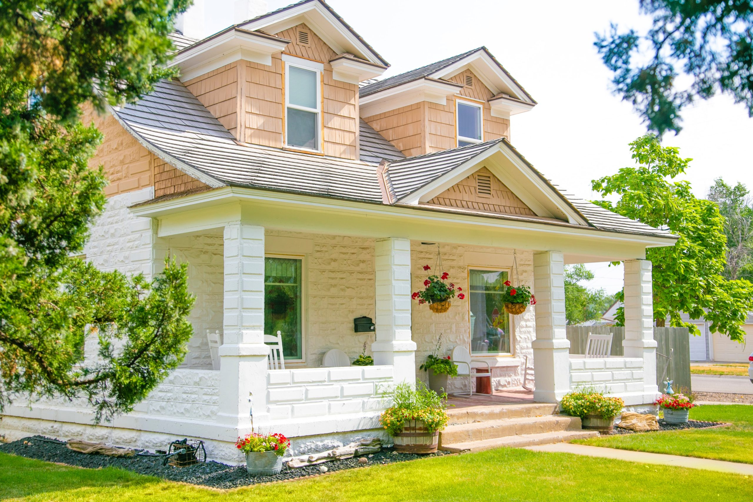 White and tan house that has followed many curb appeal tips